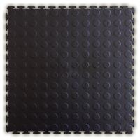 Medallion exposed interlocking PVC floor tile.